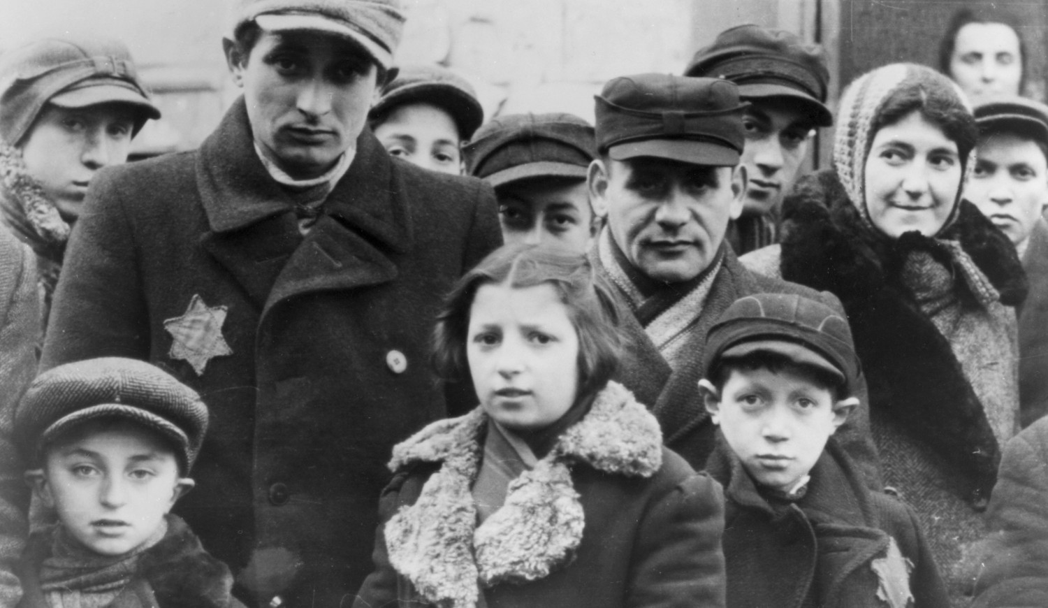 Jews wearing Star of David badges, Lodz Ghetto, Poland. The Nazis forced Jews into over-crowded ghettos from which thousands were deported to the death camps. (circa 1940). (Photo by Jewish Chronicle/Heritage Images/Getty Images)